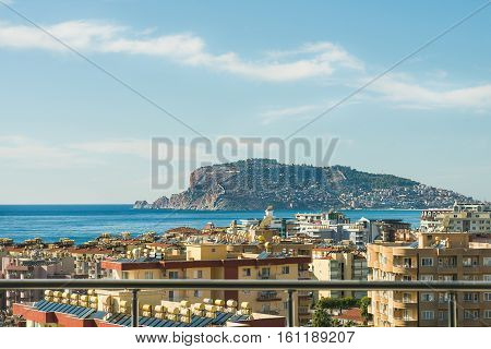 View over the castle hill of Alanya, Turkey, and Mediterranean sea from private balcony in Tosmur district. Concept of living at the sea coast