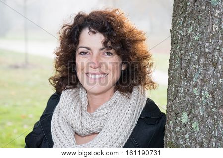 Lovely Forties Woman Outdoor Near The Tree, Waiting