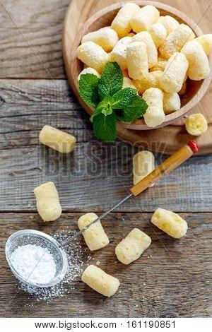 Sweet Corn Sticks And Sieve With Powdered Sugar.