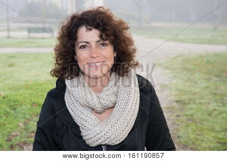 Forties Woman Outdoor In Winter Or Autumn In Park