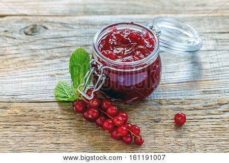 Sprig Of Red Currants And A Jar Of Homemade Jam.