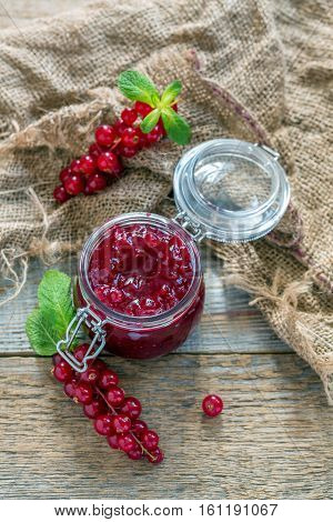 Sprigs Of Red Currants And A Jar Of Homemade Jam.