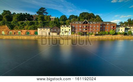 Houses on the shore of the river Exe. Long exposure. Exeter. England