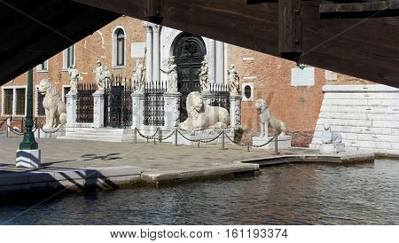 Venetia Arsenal ancient greek lions and mythological statues under the wooden bridge