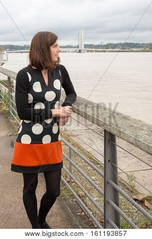 A Woman Tourism Near A River In City Tour With Fashion Dress