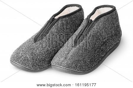 One pair comfortable dark gray slippers with fur isolated on white background