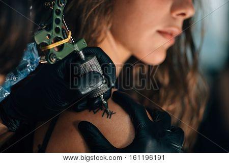 Pretty Girl Getting A Shoulder Tattoo