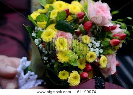 Festive small bouquet with various and colored flowers