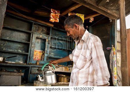 Indian man preparing Masala Tea