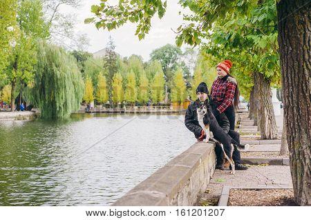 loving couple walking a dog park. good time