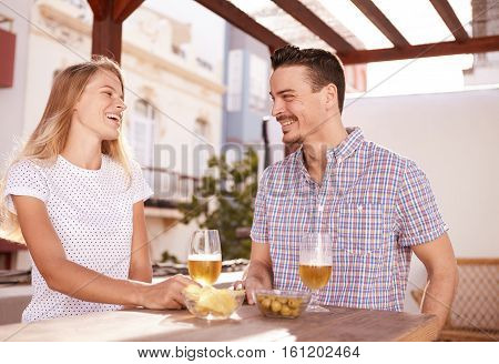 Smiling Couple Meeting Over Some Drinks