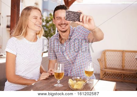 Handsome Young Couple Taking A Selfie