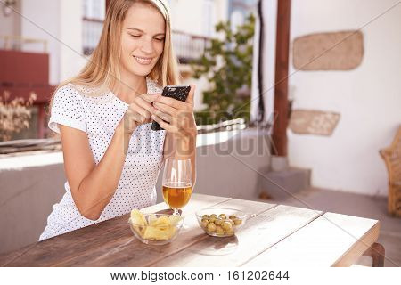 Smiling Blond Girl Typing A Message
