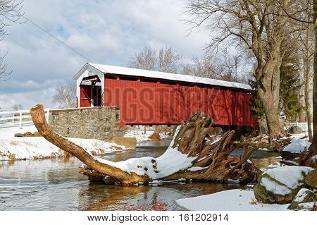 The Erb's Covered Bridge spans Hammer Creek in Lancaster County Pennsylvania USA. The bridge has a single span wooden double Burr arch trusses design with the addition of steel hanger rods.