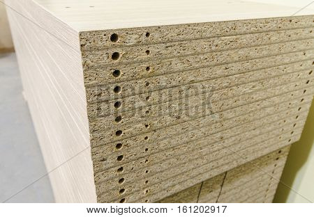 Details for the manufacture of furniture chipboard drilling in stacks