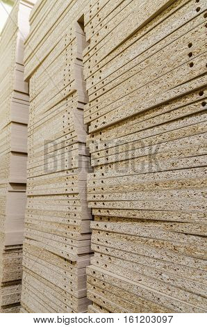 Details for the manufacture of furniture, chipboard drilling in stacks