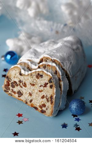 Stollen and Christmas decorations on blue background