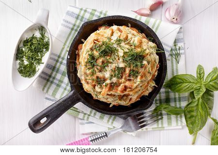 Savory vegetable waffles with cheese and herbs. Top view.