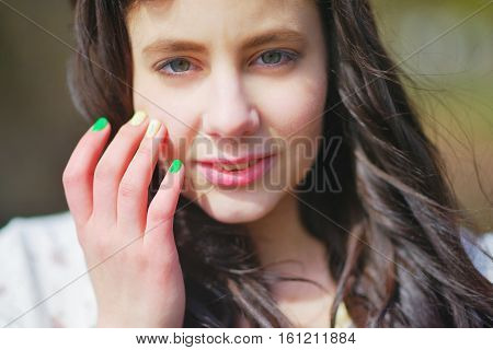 Portrait of young attractive women with extremely beautiful eyes in the open air in windy weather close up