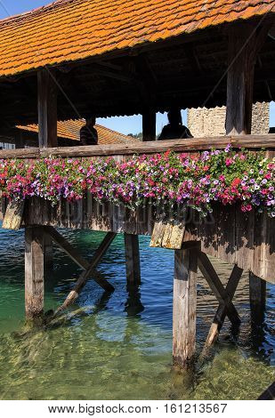 Lucerne, Switzerland - 10 June, 2014: famous Chapel Bridge close up. The Chapel Bridge is a covered wooden footbridge across the Reuss river in the city of Lucerne, named after the nearby Saint Peter's Chapel.