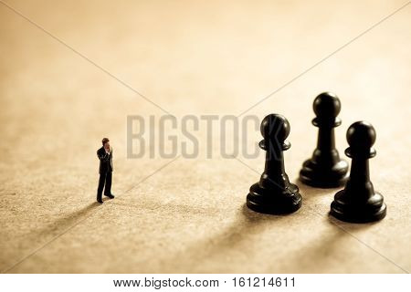 Chess and businessman. Business strategy concept. Macro photo