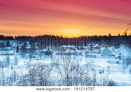 Winter sunset landscape with dramatic sky in Sweden, north scandinavian seasonal hipster background.
