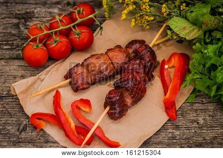 Skewers of smoked salmon on skewers with prawns and vegetables, closeup