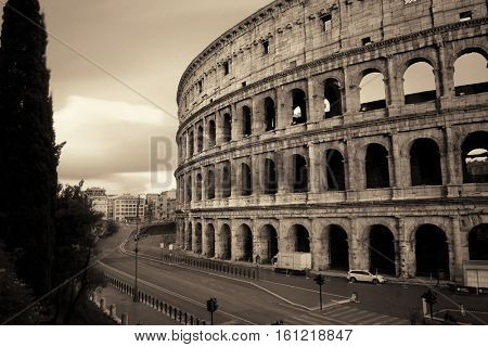 Colosseum with street view, the world known landmark and the symbol of Rome, Italy.