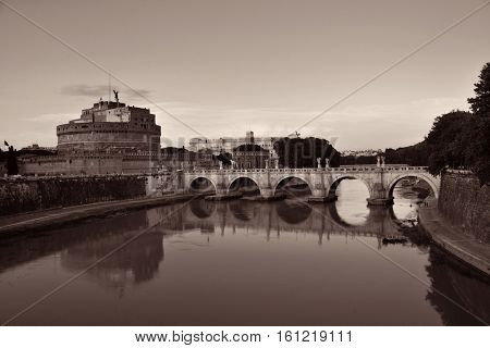 Castel Sant Angelo and bridge over River Tiber in Rome, Italy, in black and white.