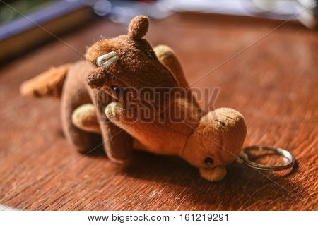 Brown plush toy horses have sex on table