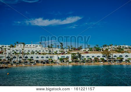 white houses in red sea situated on the beach in tropical location