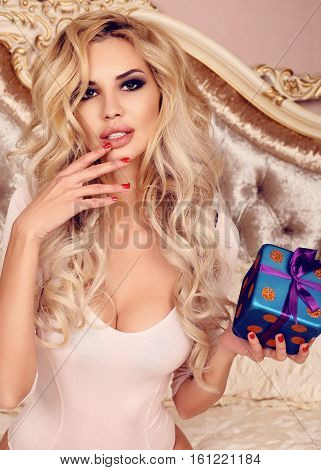 Gorgeous Sexy Woman With Luxurious Blond Hair With Christmas Present