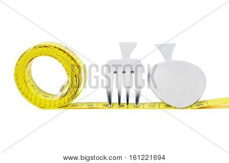 Picture of a yellow measuring meter with a spoon and fork isolated on white background
