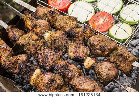 Skewers of lamb cooked on the grill.