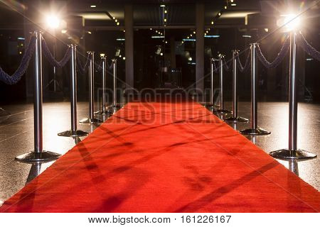 Red carpet between rope barriers on entrance.