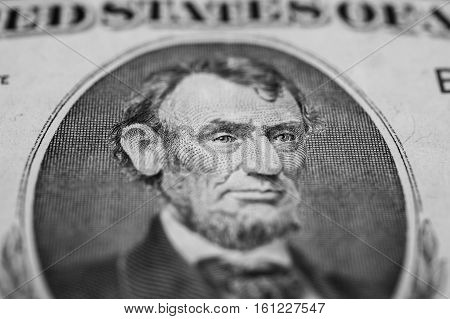 background of the money five dollar bills front side. background of dollars close up President Abraham Lincoln on the dollar bill