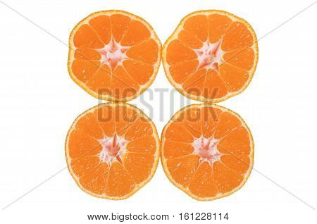 Mandarin is cut into four pieces on white background