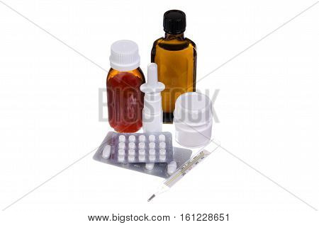 Medication pills syrup spray thermometer on a white background
