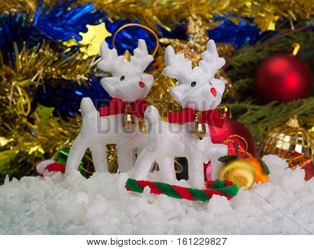 Deer Christmas and christmas decorations Placed on a wooden floor.