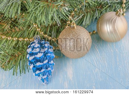 Christmas decorations and artificial fir tree branch on wooden background