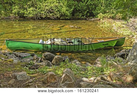 Canoe on a Remote Lake Shore on Agnes Lake in Quetico Provincial Park in Ontario