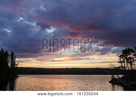 Purple Clouds and Silhouettes ar Sunset on Agnes Lake in Quetico Provincial Park in Ontario