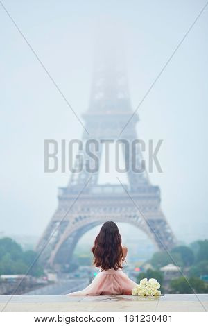 Parisian Woman In Front Of The Eiffel Tower