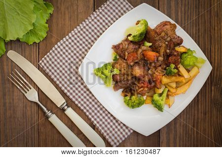 Stifado - a traditional Cypriot dishes, spread in Greece. It consists of a stew with tomatoes, potatoes, broccoli, onions, garlic and spicy spices