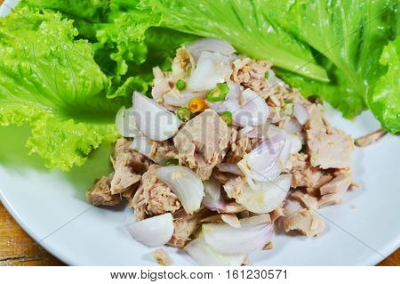 spicy tuna salad with lettuce on white plate