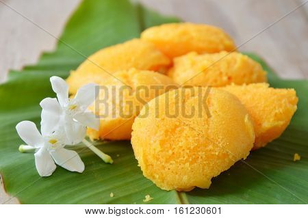 toddy palm cake Thai dessert and cape jasmine on banana leaf