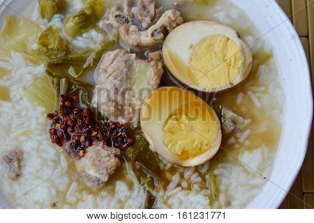 boiled rice in pickled Chinese cabbage and pork bone soup topping egg dressing fried chili paste