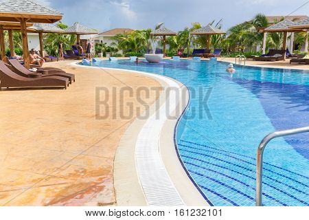 Cayo Guillermo island, Iberostar Playa Pilar hotel, Cuba, June 28, 2016, nice beautiful inviting view of comfortable cozy curved swimming pool with people relaxing, swimming and enjoying their time