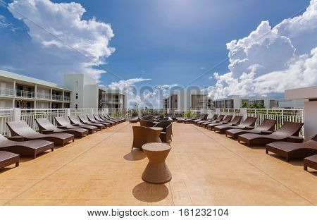 Cayo Guillermo island, Iberostar Playa Pilar hotel, Cuba, June 28, 2016, amazing gorgeous view of various modern stylish outdoor patio furniture with comfortable cozy sunbeds