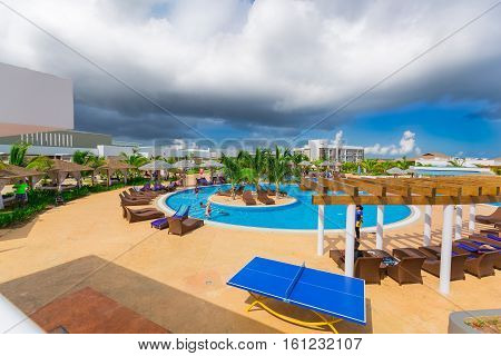 Cayo Guillermo island, Iberostar Playa Pilar hotel, Cuba, June 28, 2016, nice beautiful inviting view of comfortable cozy swimming pool with people relaxing and swimming in background